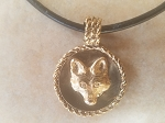 Tempi Designed Yellow Bronze Fox Mask Medallion on a Leather Cord